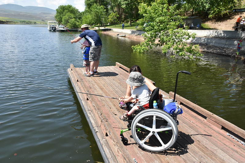 two kids and their parents fishing from the dock during the annual Richland Panfish tournament