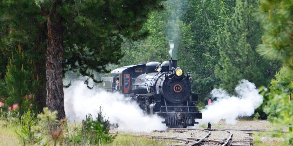 Historic Steam locomotive coming down the tracks around a corner